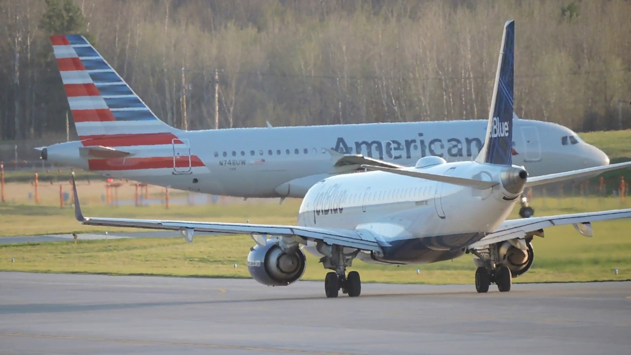 American Airlines and JetBlue planes on tarmac