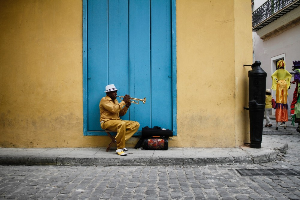 Cuban street musician playing a brass instrument