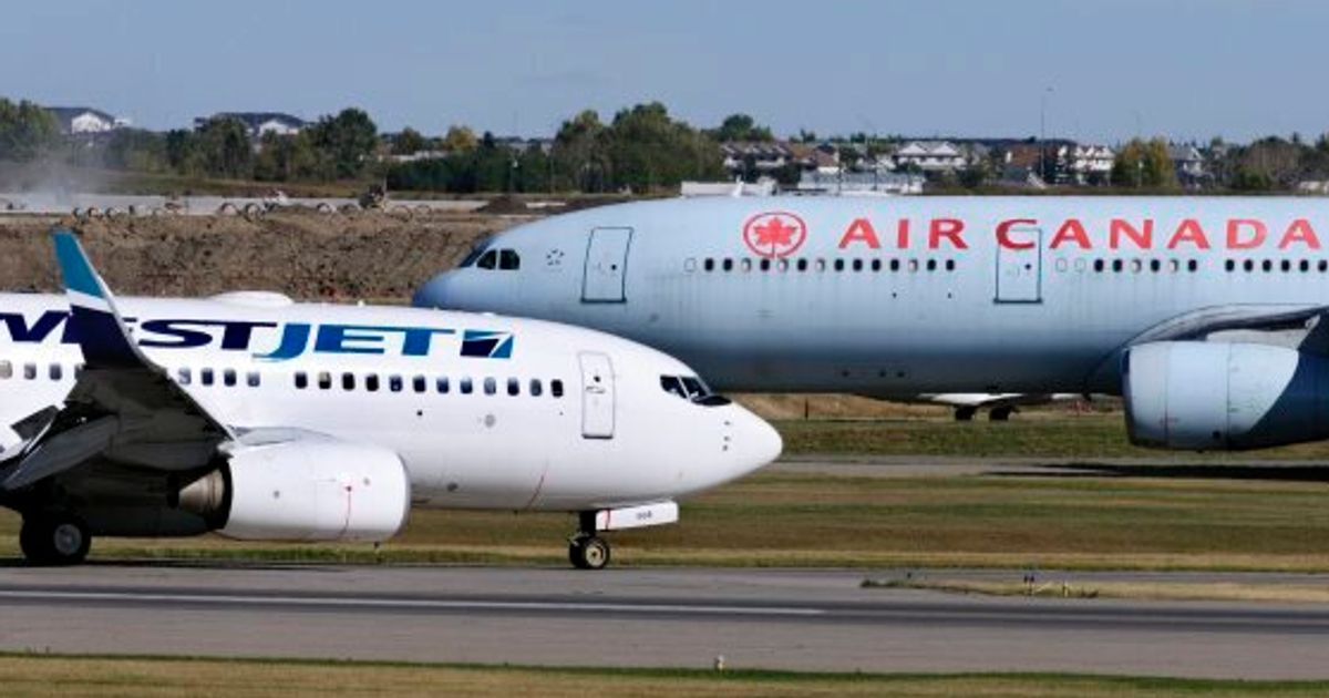 Air Canada and WestJet aircrafts on tarmac