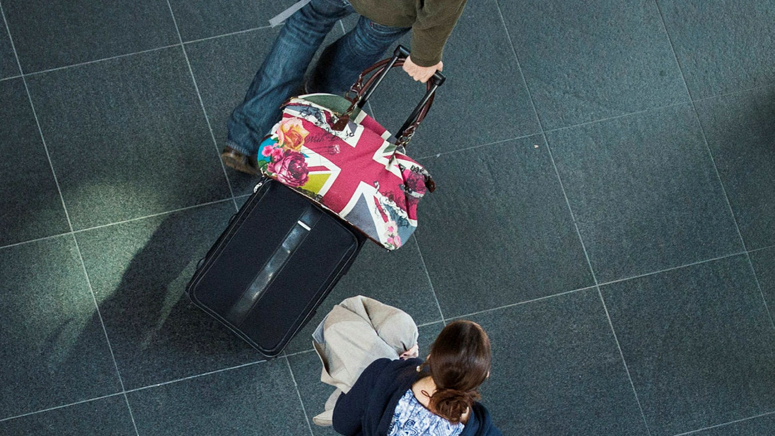 Two people with bags, British flag, viewed from above