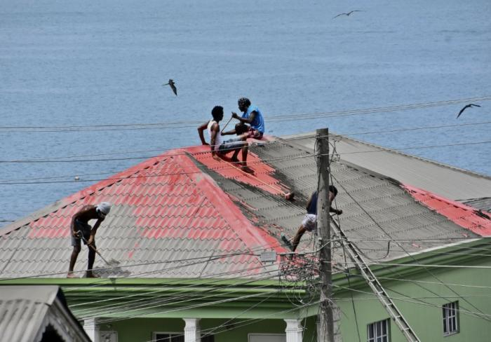 three people on a roof in St. Vincent