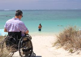 man on a wheelchair at the beach