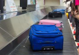 hand luggage on a conveyer belt