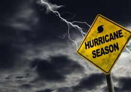 hurricane season sign and bolt of lightning