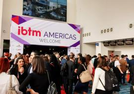 IBTM Americas welcome sign and visitors