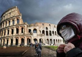Rome Colliseum and man wearing a mask