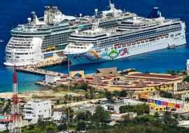 RCCL and Norwegian cruise ships side by side in a terminal