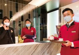 front desk workers with masks