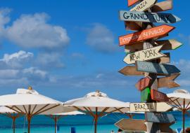 Providenciales Beach with country sign on the sand