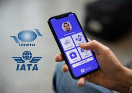smartphone in hand and IATA and UNWTO logos