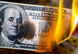 dollar in flames
