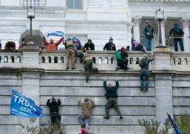 rioters climbing Capitol walls