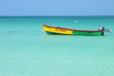 boat on a beach in Jamaica